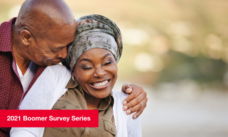 Middle-aged couple embracing, smiling joyfully