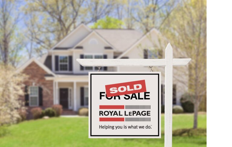 Royal LePage sold sign in front of a house on a sunny day